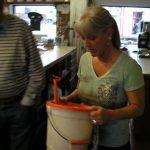 woman weighing fish