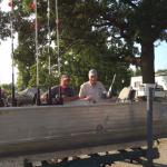men sitting on fishing boat